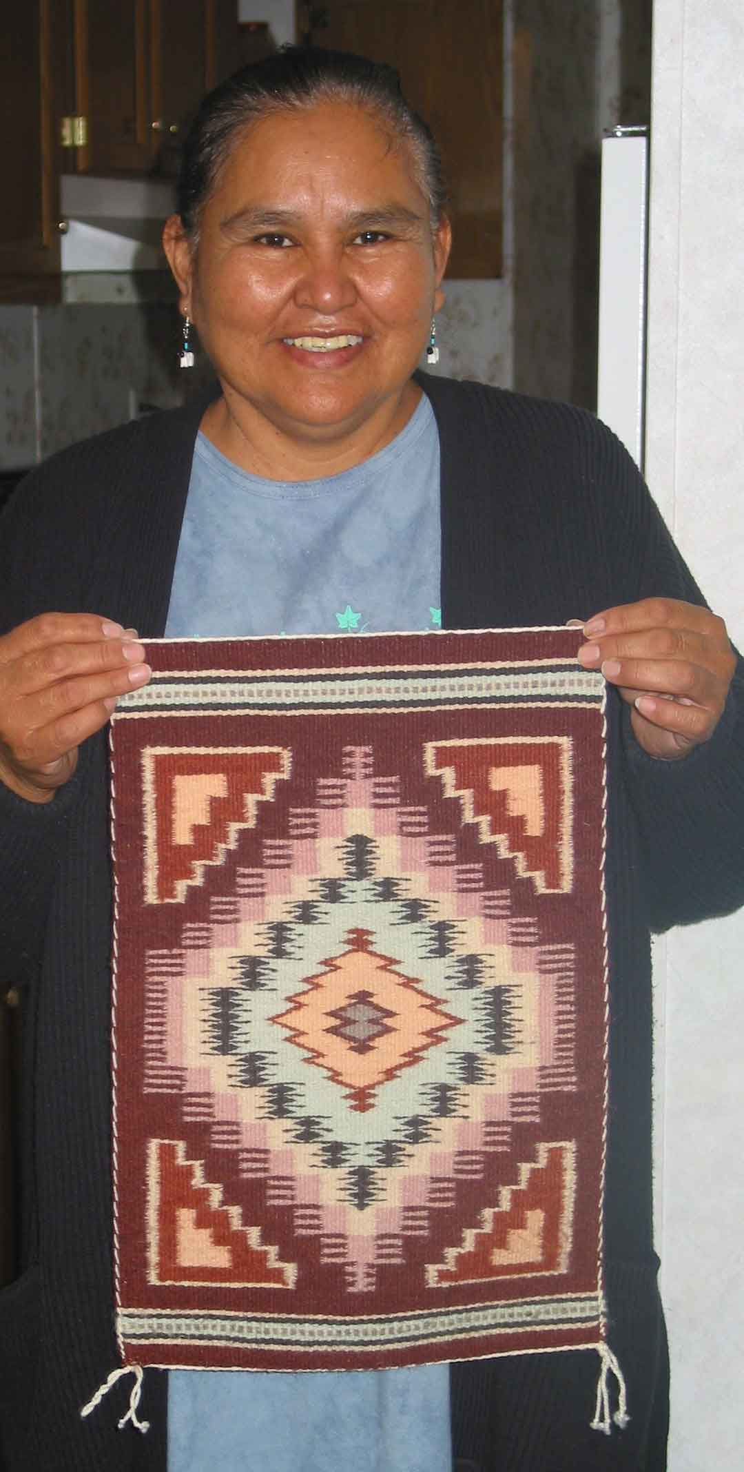 Jennie Slick shows a finished rug